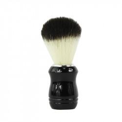 Pędzel do golenia z czarno- białego włosia syntetycznego. Rączka pędzla czarna ze srebrzystą obwódką.