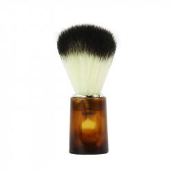 Pędzel do golenia z włosia syntetycznego. Włosie czarno- białe, rączka w kolorze bursztynowym.